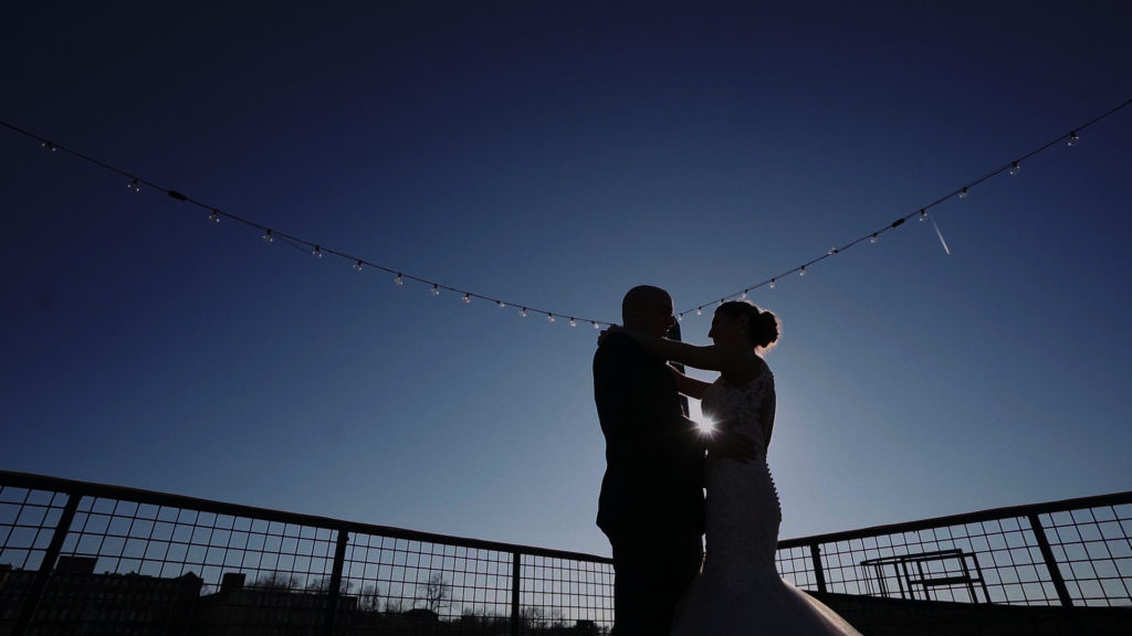Sunset wedding kiss in St Louis