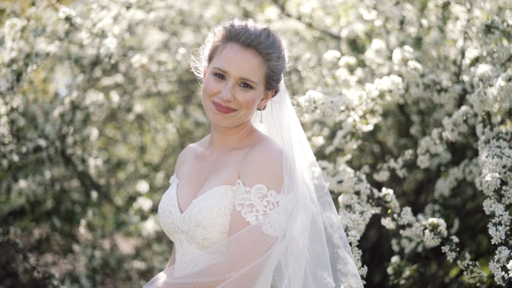 Beautiful Bride in the Garden on her wedding day - wedding videography