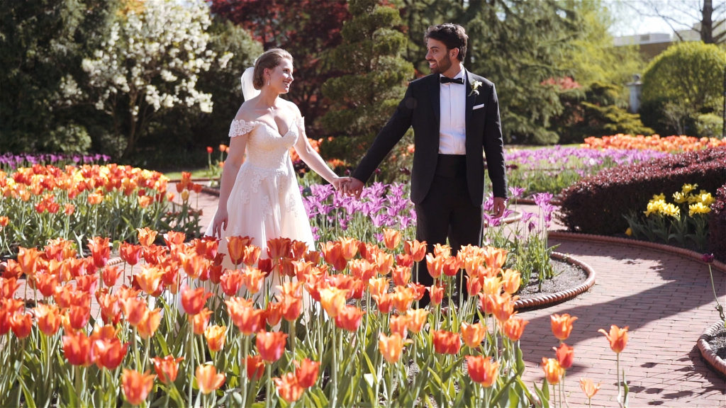 Bride and Groom walking in the Tulip Garden